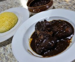 Oxtail with Black Beans and Yellow Rice