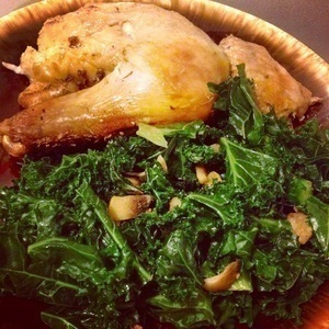 Baked chicken thighs with sautéed kale and mushrooms